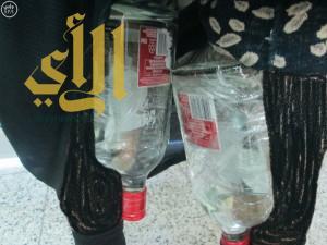 جمرك جسر الملك فهد يُحبط محاولة سيّدة تهريب 21 زجاجة خمر