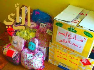 """طالبات يقمن بمبادرة """"امسح دمعة يتيم"""" في ثانوية القابل بنجران"""